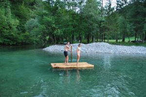 Chris + Em on a raft at the swimming hole (OO.cup, Slovenia)
