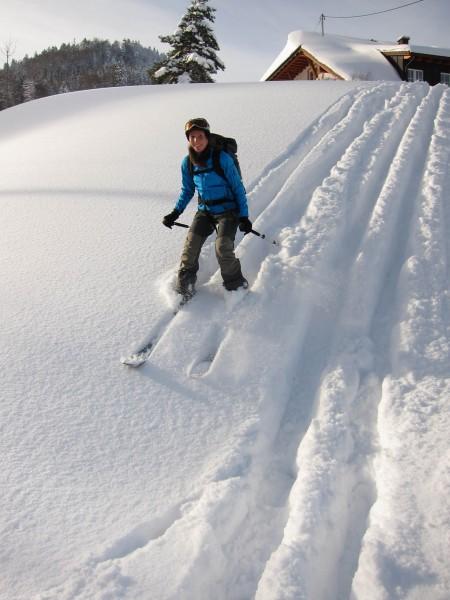 Leonie skiing down in powder (Skitour Stübenwasen)