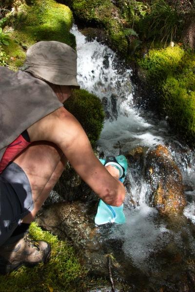 Leonie filling her water bladder (Rabbit Pass Tramp Dec 2014)
