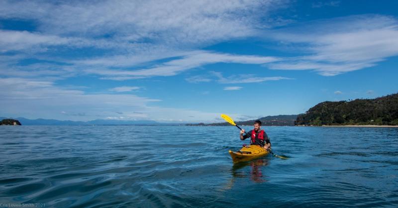 Craig in the yellow kayak (Seakayaking Abel Tasman April 2021)