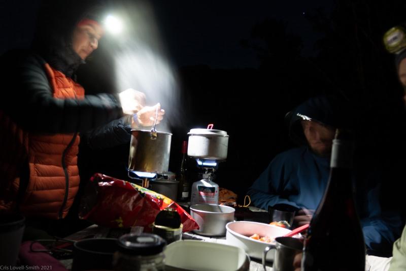 Ellen cooks dinner (Seakayaking Abel Tasman April 2021)