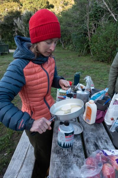 Ellen cooks pancakes (Seakayaking Abel Tasman April 2021)