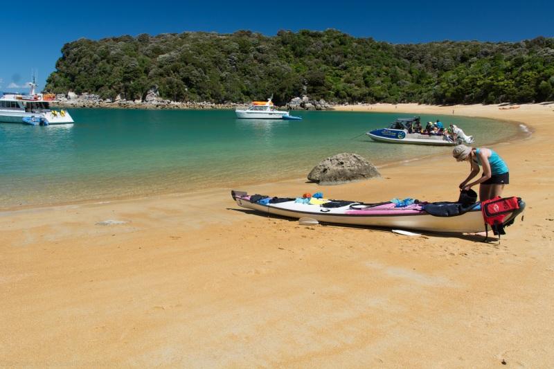 Leonie packing the kayak (Seakayaking Abel Tasman Dec 2014)