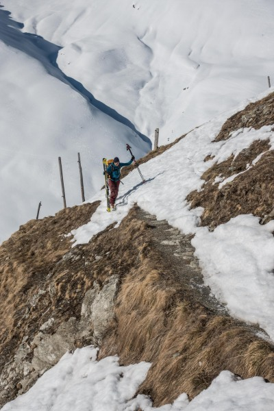 Birgit carries her skis (Ski touring Avers March 2019)