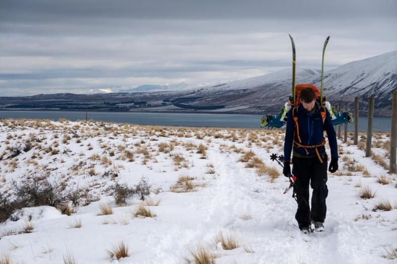 Craig walking with skis (Ski Touring Camp Stream Hut Aug 2021)