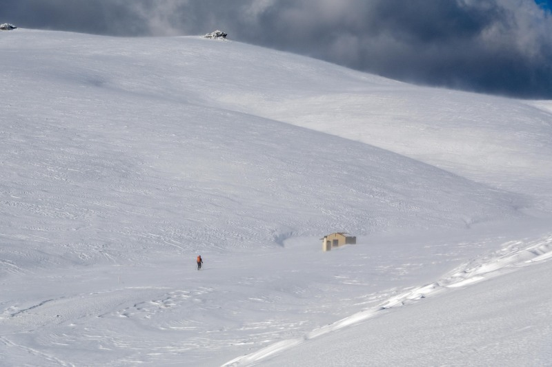 Craig nearing the hut (Ski touring Kirtle Burn Hut August 2021)