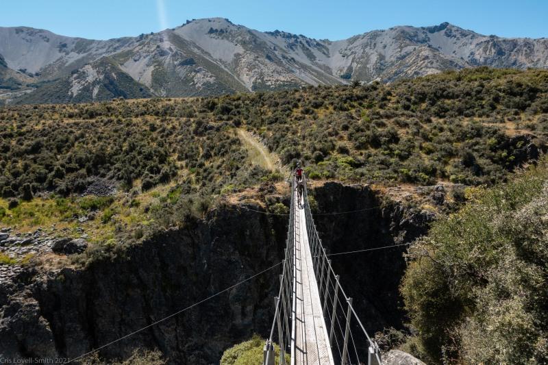 Crossing on a swing bridge 2 (Cycling St James)