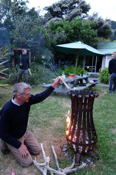 Dad tends the fire (Takaka 2013)