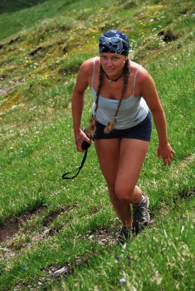 Frauke climbing a hill (Tramping Schrecksee, Germany)