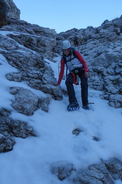 Leonie descending with crampons (Brenta Dolomites)