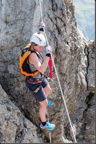Leonie on a steel rope bridge (Karhorn Klettersteig)