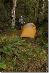 Cris presenting the pitched tent (Klondyke Valley Tracks)