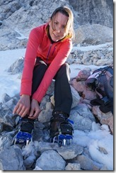 Leonie putting on her crampons (Brenta Dolomites)