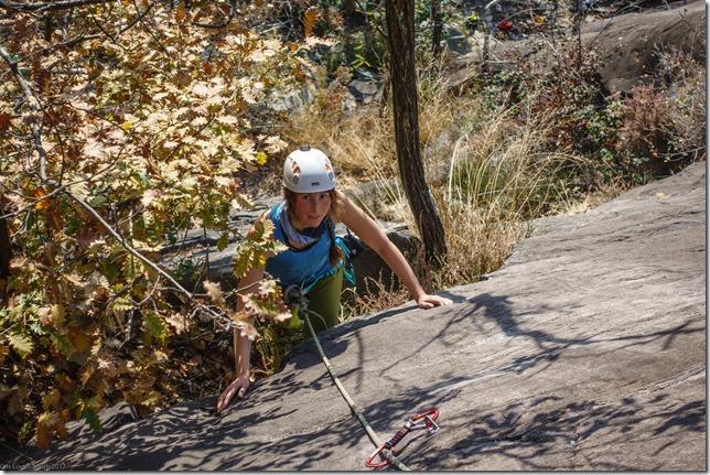 Leonie starting a climb (Multipitch in Ticino Oct 2017)