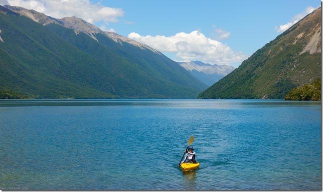 Ari kayaking across the lake (Ari visits 2020)