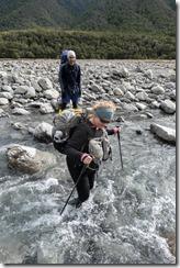 Katie crossing a river (Tramping Hawdon Hut Sept 2021)