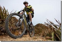 Julian cranking the pedals (Mountain biking Paparoa Track Oct 2021)